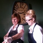 Our Chefs Lois and Gail Carving The Hog Roast